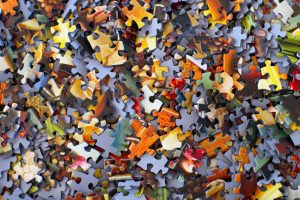 multicoloured jumbled jigsaw pieces
